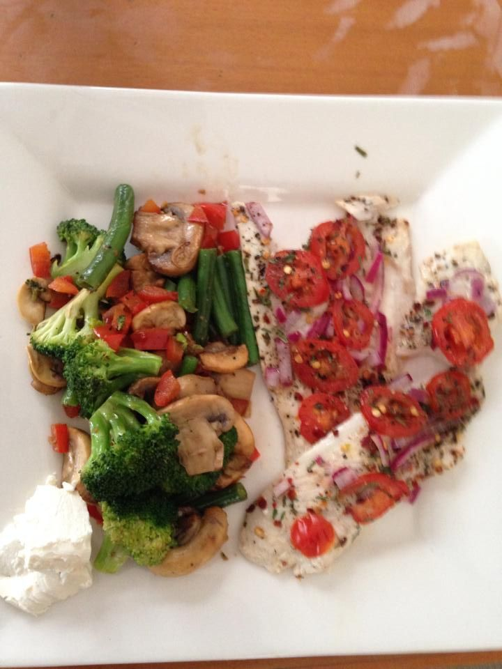 Tomato, chilli  herb baked fish with a meddly of veges
