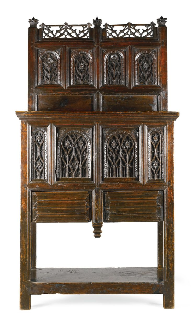 France, 15th/16th century DRESSOIR walnut, with a central cupboard above two linenfold carved drawers, restorations, the lower section with some typical rebuilding branded in four places with a pantocrator Walnut . Made circa 150