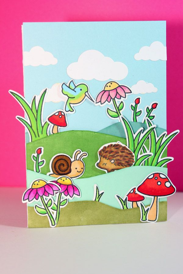 Lawn Fawn Gleeful garden and sending Hedgehugs stampsets. Memorybox die for the clouds and green inks is Distresss inks from Ranger. coloured with Spectrum Noir and Copic alcohol markers and some Stabilo waterbased ones