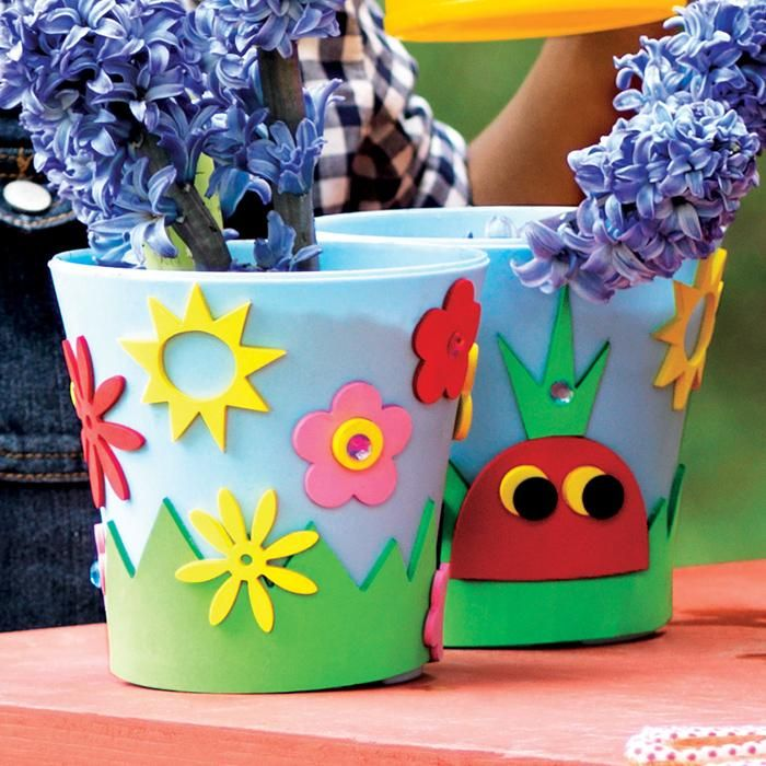 growing up a gardener a kid size planting pots and stickers with a pint size water can so they can be a pro garden guru like you