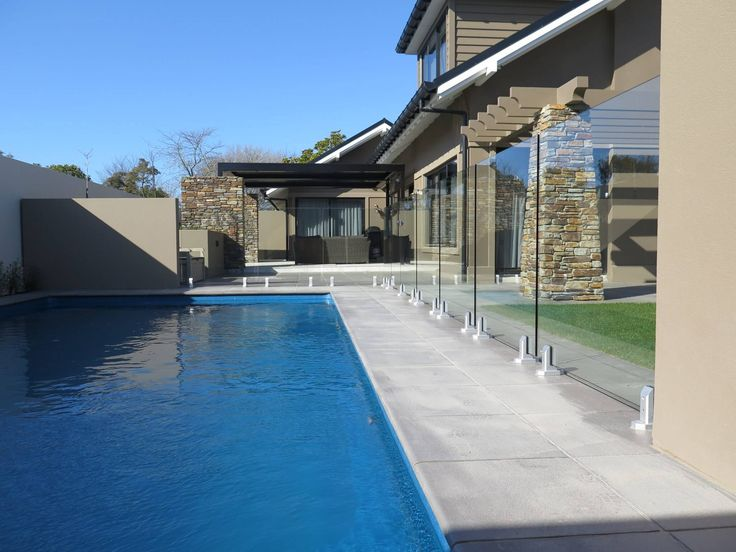 Frameless glass walls combined with the pre-exisiting concrete walls offer this pool owner with the ultimate privacy solution while maintaing a clear view of the outdoor area.   #poolfencing #glass #seamlessview   For more inspiration check out https://www.boundaryline.co.nz/case_study/