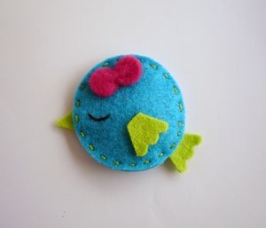 Little bluebird crafted from felt. For an easier swap, glue craft foam shapes together instead of using felt.