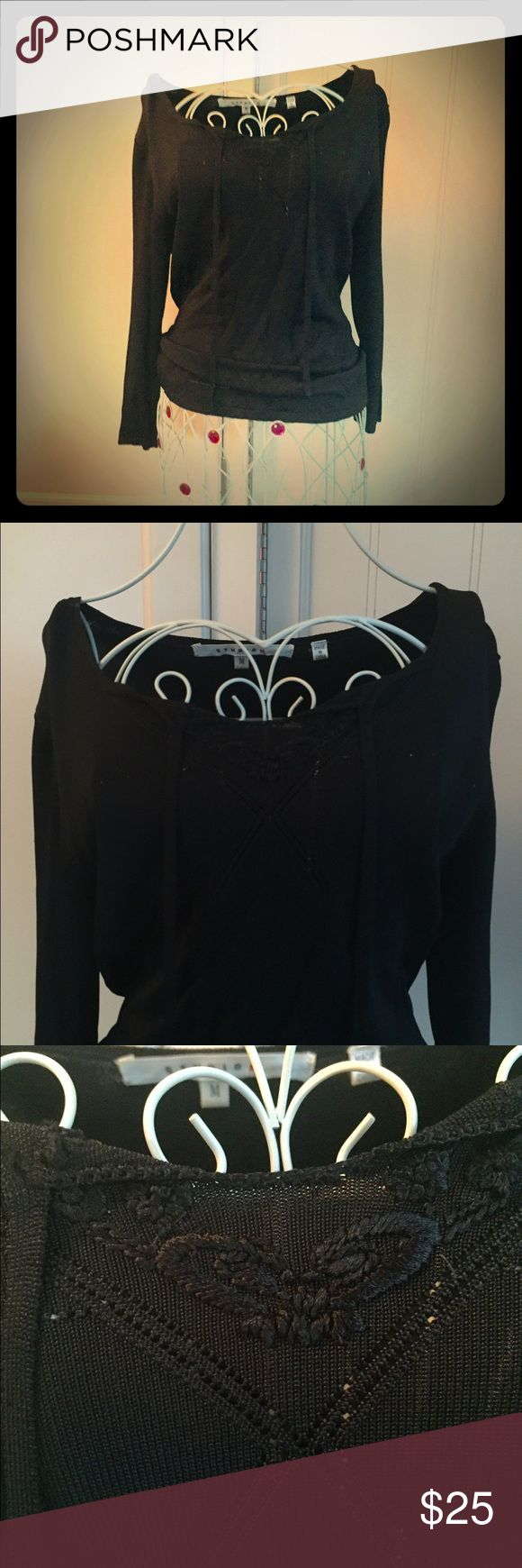 Black embroidered sweater Simple and classic black sweater with beautiful embroidery at the neckline with tie detail. It's very hard to see the detail in the photos so I used my brightest flash in the final picture. The little white marks are areas where the white dress form glowed under the flash, they are not flaws in the sweater. Gently worn. Studio M Sweaters