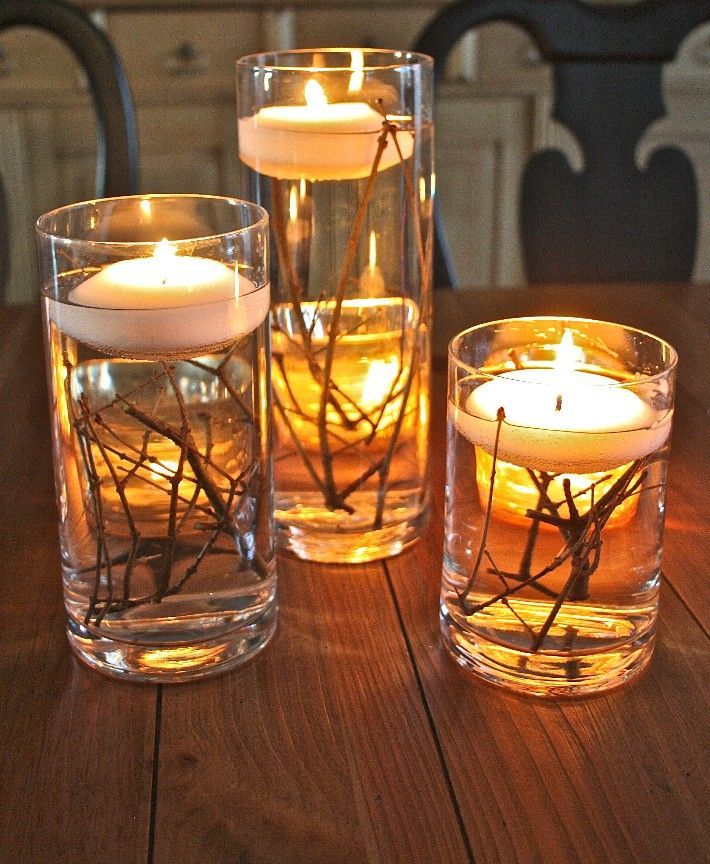 Twigs in clear vases with water and floating candles / thefamilyceoblog.com