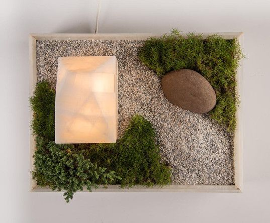 Mokki is half planter, half LED lamp that resembles a tiny home with a living landscape surrounding it.