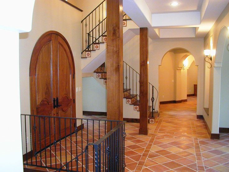 This amazing front foyer is the epitome of a Spanish home! The Traditional Saltillo Terracotta tile really adds the perfect finishing touch to this lovely space.