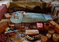 Reconstruction of a female Viking burial during the Iron Age occupation of the UK.