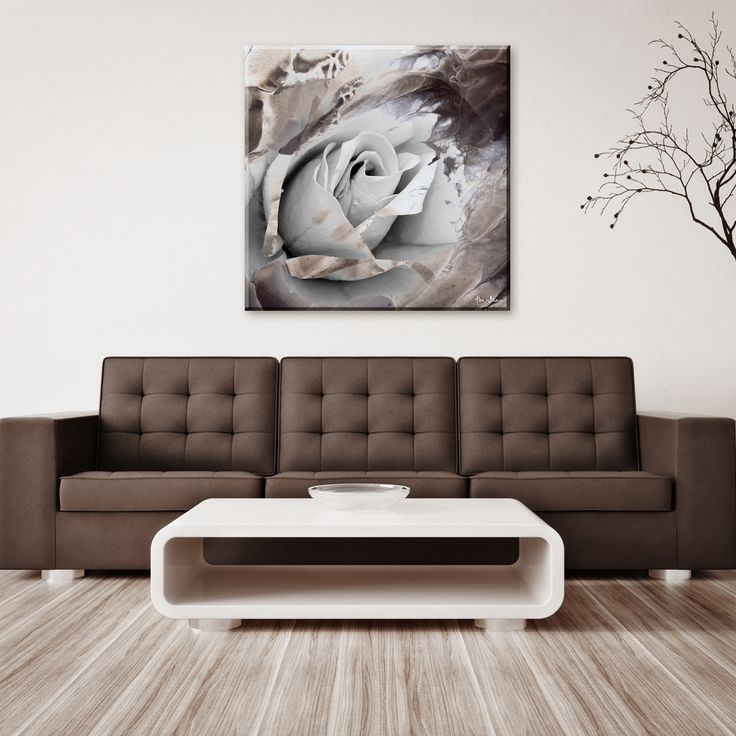 The 'Painted Petals XLVII' canvas art depicts a monocromatic rose, scattered water sprays delicately pouring off the canvas with dark highlights creating a balanced look.