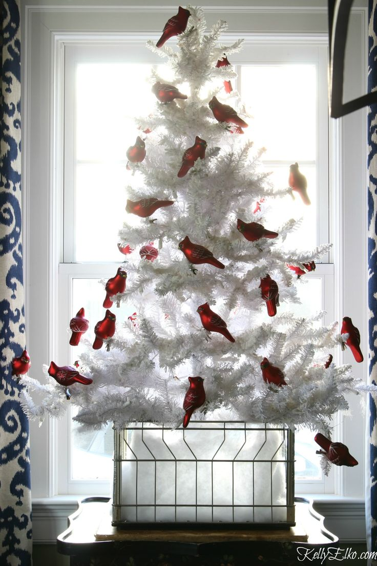 Red and white christmas decorations - Love This Flocked White Christmas Tree With A Flock Of Red Cardinal Ornaments Kellyelko Com