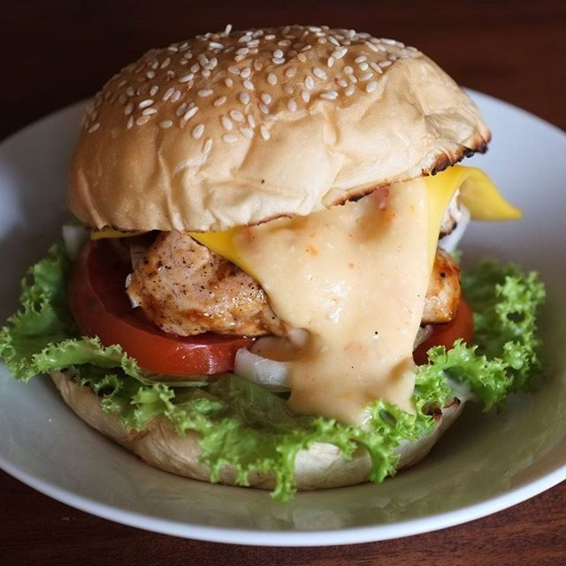 Less oil burger from #kedaiipeh, its grilled not pan fried. Grilled Chicken Burger and Cheese with Spicy Cheese sauce . You can ask for degree of doneness, if you don't they will give you well done degree