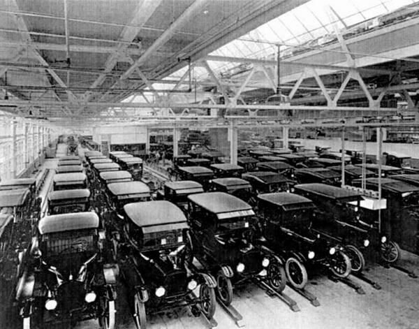 View inside the Ford Motor Company factory with rows of new Model T motor cars