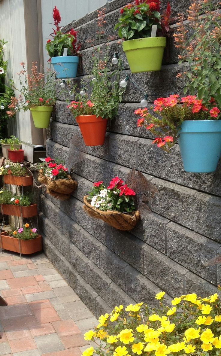 Painted Clay Pots Secured To Keystone Wall With Hangapot Hangers From  Philadelphia Flower Show Customers