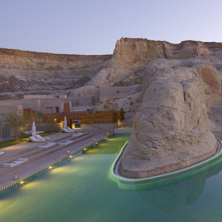 Hidden in the canyons of Utah, in a valley of stark, sweeping dunes and plateaus, sits an 11,000-plus-square-foot sunken pool—heated to 86 degrees year-round—and hot tub that butts up against a 165,000-year-old sandstone rock. The setting is otherworldly and blissful, especially when you're cuddled on a king-size daybed that seems to float on the water.