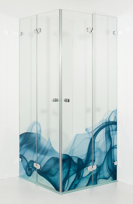 A unique way to make a bathroom feel luxurious by digitally printing on glass.  The blue pattern matches in with what water looks like.