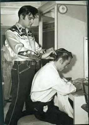 Elvis Presley cutting Johnny Cash's Hair, 1960