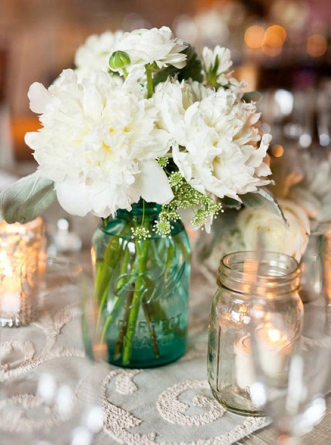 blue mason jar wedding centerpiece with white