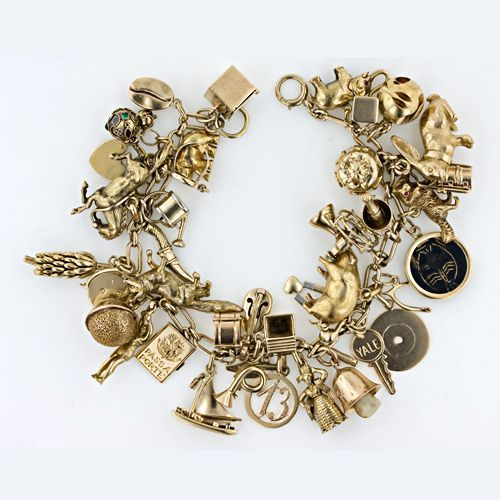 Popular 1950's gold charm bracelet...I still have my mother's...very much pre 1950's - all the charms have working parts.