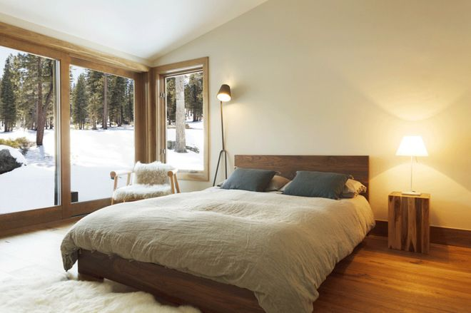 rustic bedroom by sagemodern - A soft and fuzzy sheepskin will feel great underfoot as you step out of your warm bed into a cold bedroom. Smaller sheepskin throws can cozy up metal or wood chairs.