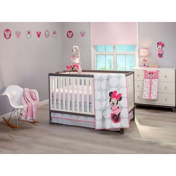 Add a spot of color with this pretty polkadot set featuring Minnie Mouse in a modern design with brightly styled polkadots in light pink, gray, white and bright raspberry. The set includes a grey quilt with white dots, appliqued Minnie Mouse, and a bold raspberry border, pink crib sheet with crisp, white pinstripe pattern made of mini dots, delightful diaper stacker in matching all-over icon print with Minnie applique...