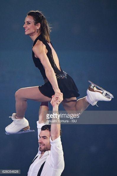 Meagan Duhamel and Eric Radford of Canada perform...