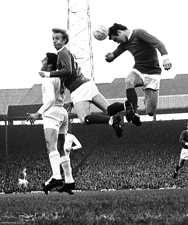 Real Madrid and Manchester United, in the shape of one Real player and United's Denis Law (centre) and John Aston (right) go high in the air in their battle at Old Trafford. 1968