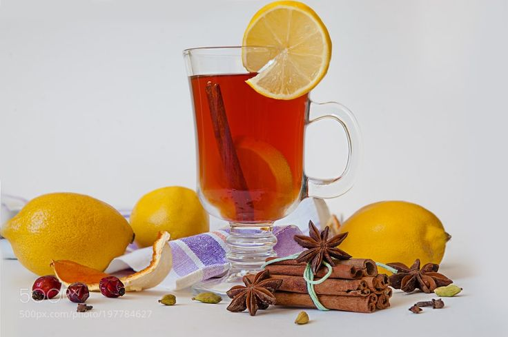 mulled wine in a glass of Irish with lemon cinnamon cumin decorated by NataliyaDorokhina from http://500px.com/photo/197784627 - Glass with Hot red mulled wine for winter and Christmas with orange slice anise and cinnamon sticks on white background.. More on dokonow.com.