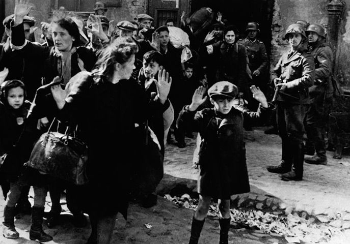 """Photographer unknown """"Jewish Boy Surrenders in Warsaw"""" 1943 This image is just heartbreakingly powerful and moving because fear is evident in the boys eyes yet he stops to surrender because he has no other choice."""