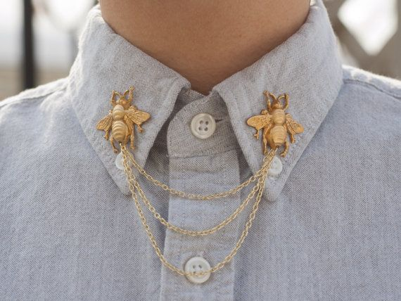 These bees are like Victorian illustrations come to life and are sure to liven up your shirt collar. Attaches with two pins on the back of each