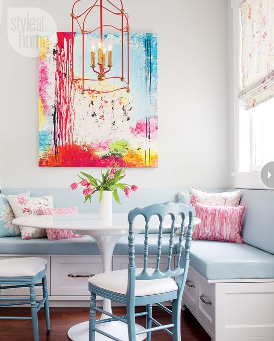 Style at Home - kitchens - eat in kitchen, L shaped banquette, built in banquette, L shaped built in banquette, blue cushions, banquette cushions, pink and blue pillows, abstract art, dining room art, red lantern, dining room lantern, saarinen table, saarinen dining table, turquoise chair, turquoise dining chair, turquoise blue dining chair, turquoise accents, turquoise blue accents,