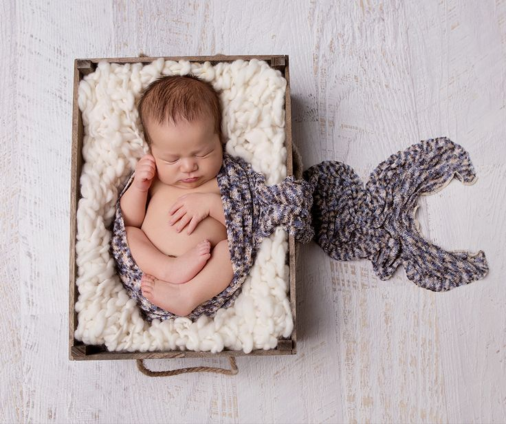 Natural coloured wool knitted chunky blanket prop being used as a basket stuffer by made from