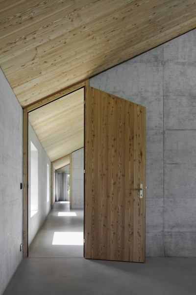 House D- wood door and concrete wall