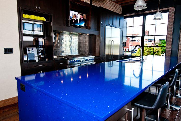 Modern loft kitchen with blue quartz countertop More