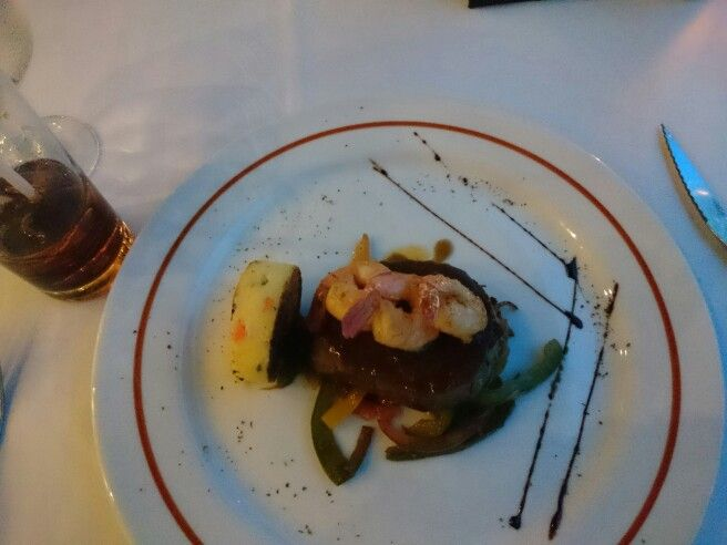 Filet Mignon and Grilled Shrimp surf and turf over a bed of fresh sauteed vegetables, at the Ciao Restaurant at the Hard Rock Resort. #hardrockresort #honeymooners