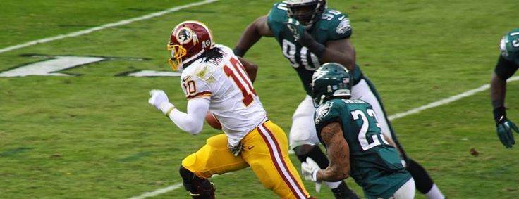 What will be the fate of Washington Redskins quarterback Robert Griffin III (RG3)? (Robert Griffin III on a read-option run during the Redskins 24-16 loss to the Eagles in the 2013 season) #quarterback #RG3 #sportsstrategy