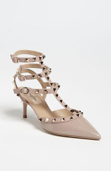 Valentino 'Rockstud' Pump | Golden pyramid studs glint on the caged straps of an edgy patent leather pump with a slim heel and pointed toe.