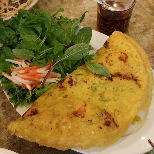 Bánh Xèo  Vietnamese pan fried crepes made with rice flour, water, turmeric powder and coconut milk (stuffed with slivers of pork, shrimp, and bean sprouts)   (Saigon)  Customer photo via Instagram