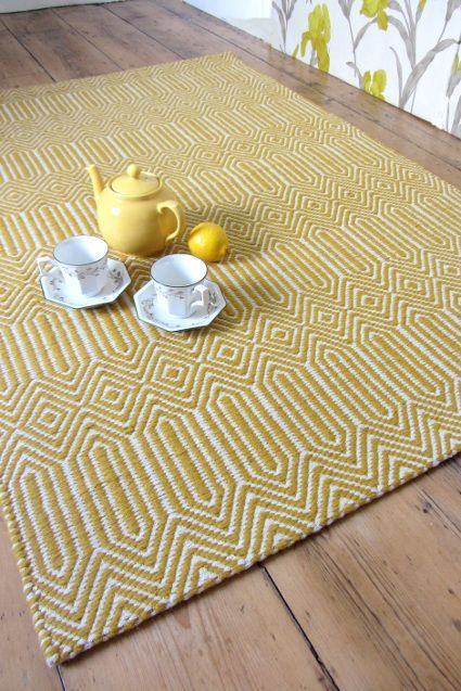 Sloan Mustard Rug.... This very popular rug comes in a fresh, light gold mustard colour. The pile is a firm wool weave over a cotton base, and the maze like pattern has hints of North African rug design. A fresh, vibrant rug in a lovely tone of light mustard yellow.