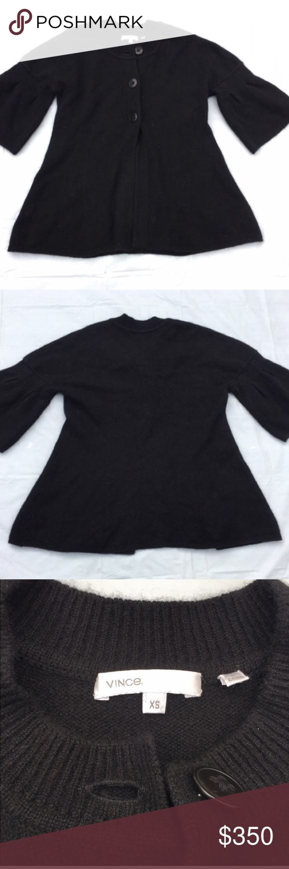 Vince black cashmere sweater SZ  XS. Vince black 100% cashmere sweater. Size XS. Excellent used condition. Half sleeves with bell shape. 3 button crew neck cardigan style. Falls to hips. A must have wardrobe staple! Vince Sweaters Cardigans
