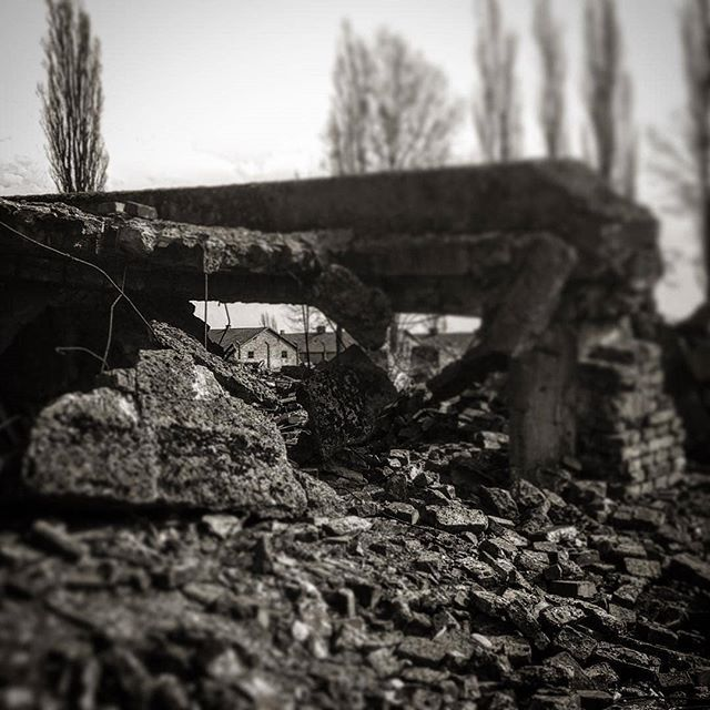Auschwitz II-Birkenau. Ruins of gas chamber and crematorium II. In the background a prisoner barracks. --- Photo by @rbnbrt --- #Auschwitz #Birkenau #AuschwitzMemorial #history #Holocaust #Shoah #Jews #genocide #Nazi #Germany #concentrationcamp #architecture #ruins #bw #crematorium #gaschamber #memorial #memory #museum #Poland #igerspoland #UNESCO #worldheritage #worldHeritagelist #igersbw