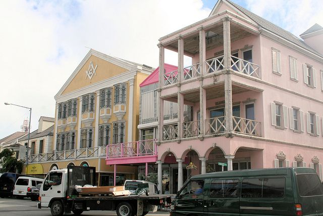 Nassau, Bahamas- The building downtown are beautifully painted in water colors, you can get around in bus or taxi or even walk...venders line the street for cooking and selling....