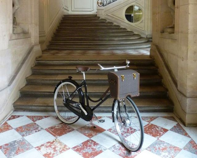 """La Malle Bicyclette Before Louis Vuitton and Goyard there wasMoynat, theoldest French trunk manufacturersfounded in 1849. The luxury brand recently created a bicycle featuring a picnic """"basket""""equipped with plates, cutlery, drawers for sandwiches and a place for wine glasses. Functional and trés chic? Absolutely. Within my budget? Not even close. But a girl can dream . . ."""