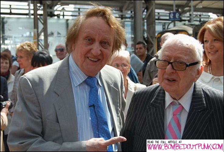 Liverpool Comedian Ken Dodd (who also gets an oblique reference in Bombed Out! to do with law enforcement) stands with Solicitor, E Rex Makin, on the right.