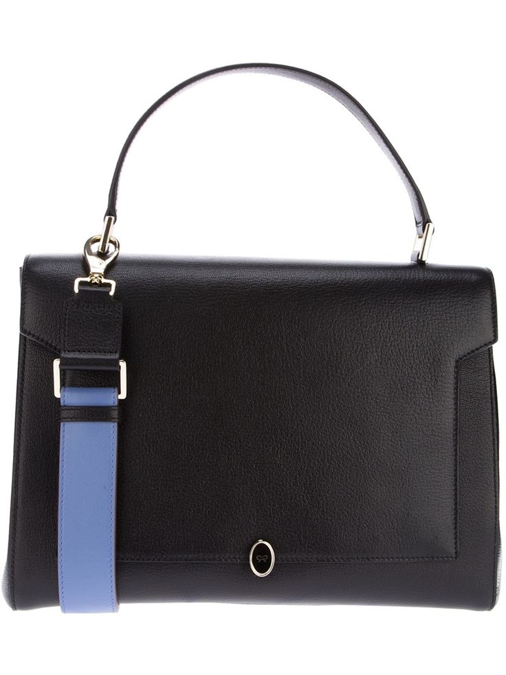 Black leather satchel from Anya Hindmarch featuring top handle, press stud fastening sides and fold-over front with signature bow gold-tone and black enamel twist lock fastening. http://zocko.it/LDlIv