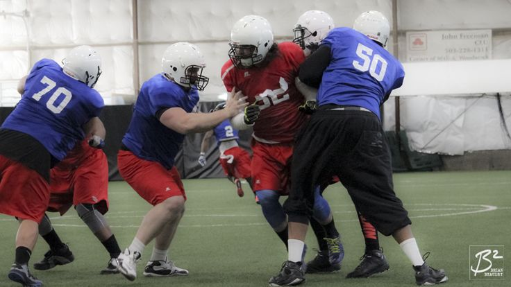 Brandon Tett tries to break through John Collins and Jeraill McCuller at the 2015 Portland Thunder intrasquad scrimmage.