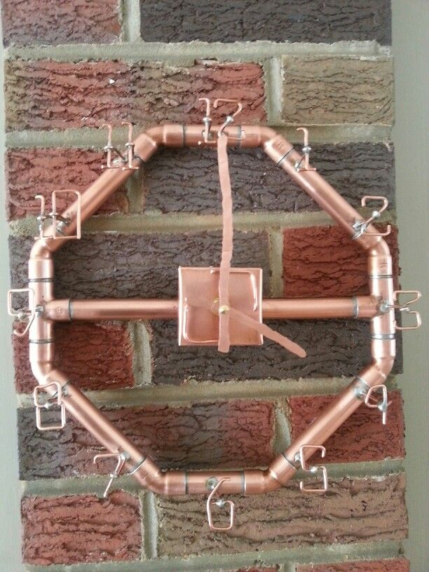 Copper clock I made out of copper pipe and old copper electrical ground wire. Clock numbers are formed out of ground wire, clock hands are copper wire hammered down to flatten them. Just something I had in my head....