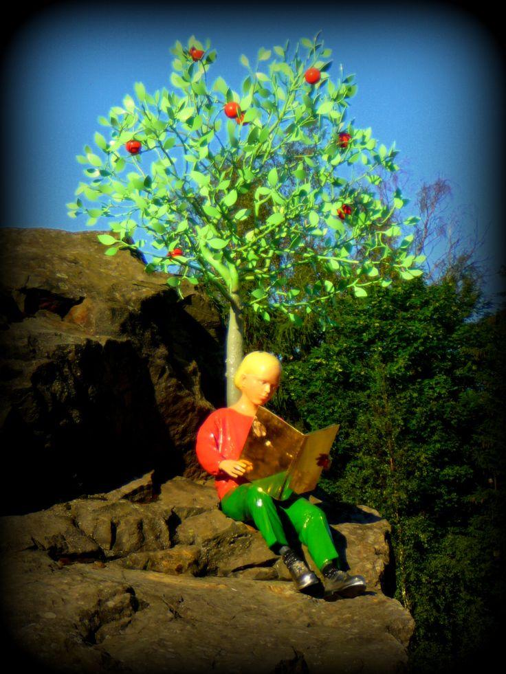 J.V. Snellman sitting on the stone under the apple tree #kokkola