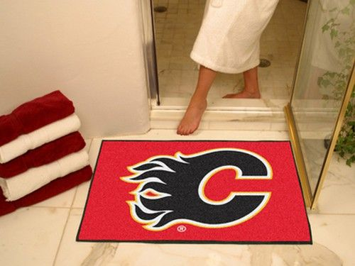 Calgary Flames floor mat. This Flames rug can serve as a door mat, or a floor rug. Mat is chrome jet printed, allowing full penetration of the color down the entire tuft of the high luster nylon yarn