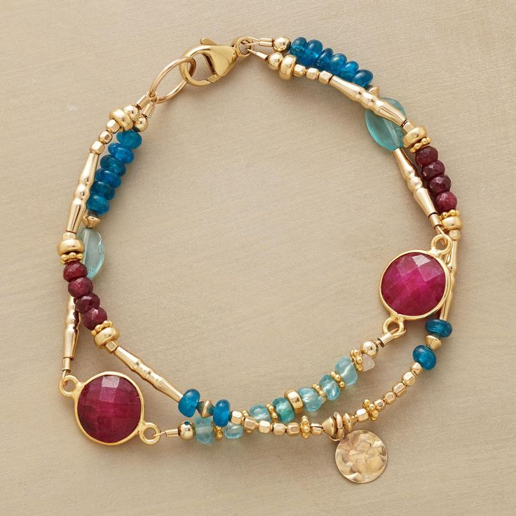 """RUBY BLUES BRACELET--Ruby rounds in golden rims are spotlights amid a two-blue mix of apatites, smooth and faceted. Paillettes and a variety of 14kt goldfill beads lend their glow. Lobster clasp. Sundance exclusives handcrafted in USA. Approx. 7-1/2""""L."""