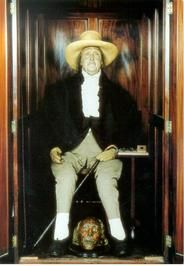 The 'Auto-Icon' of philosopher Jeremy Bentham at University College, London.    The cabinet contains Bentham's preserved skeleton, dressed in his own clothes, and surmounted by a wax head. Bentham requested that his body be preserved in this way in his will made shortly before his death on 6 June 1832. The cabinet was moved to UCL in 1850.