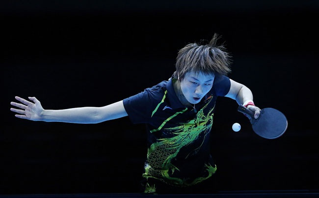 China's Ding Ning on her wayto winning gold in Women's Team Table Tennis Gold Medal Match against Japan